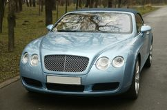 Car on the road. Bentley , fast, sportage and exclusive car for businessman Royalty Free Stock Images