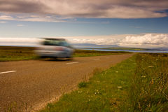 Car on the road. The road leading to end of british mainland and car on the road Royalty Free Stock Image