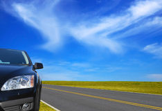 Car on the road. With beautiful sky Stock Images