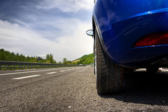 Car on a road. In the countryside Stock Photography