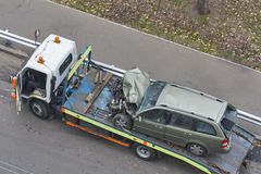Car after road accident shipped to tow truck. Car broken during a road accident shipped to a car wrecker stock images