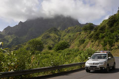 Car on the Road that Cross Malagueta Sierra, Cloudy Mountains Landscape, Cape Verde Royalty Free Stock Image