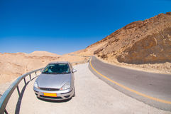 Car on the road in the desert Royalty Free Stock Images