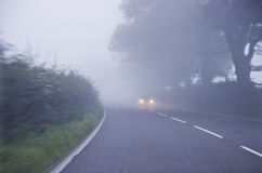 Car on the road in the fog. Autumn landscape Stock Photos