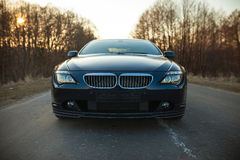 Car on road, front side. Car on village road, front side Royalty Free Stock Images