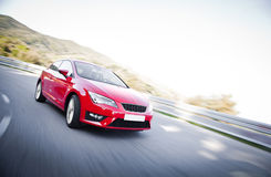 Car on a road full of dangerous bends. Red car on a road full of dangerous bends Royalty Free Stock Image