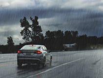 Car on the road in heavy rain Royalty Free Stock Photo