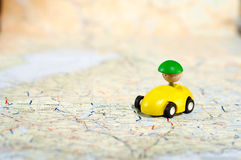 Car on road map. Photo of a Map with Toy Car Stock Images