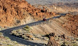 Car and road in the middle of lava fields royalty free stock photos