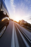Car on road with motion blur background. Royalty Free Stock Image