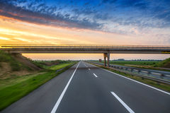 Car on the road with motion blur background. Sunrise shot Stock Photo