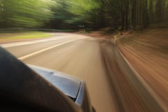 Car on the road with motion blur Stock Images