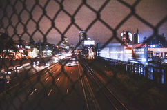 Car on Road Near City Buildingsblack Chain Link Fence Look at City Skyline at Nigh T Royalty Free Stock Photography