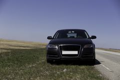 Car on the road near field. Car is on the road near field Royalty Free Stock Photography