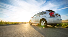 Car on road over sunny day. Gray car on road over sunny day stock photography