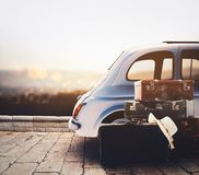 Car on the road ready for summer holiday during sunset with luggage. Leave with the car and luggage on vacation royalty free stock images