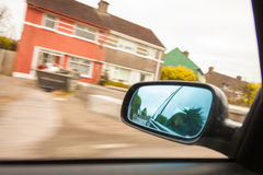 Car on the road and rear view mirror Royalty Free Stock Photography