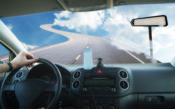 Car on road on sky. An illustration showing a car driving on a road in the sky with blank arrow road sign for any text Stock Image