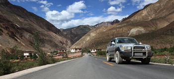Car on the road to Tibet Stock Image