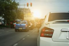 car on the road with traffic lights red Stock Image