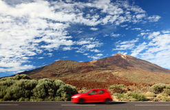 Car road trip to freedom. Road trip car in beautiful landscape with copy space. Mountains and volcano Teide, Tenerife in the background stock image