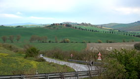 Car on a road through the tuscanian hill. S stock video footage