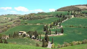 Car on a tuscanian road. Car on a road through the tuscanian hills stock footage