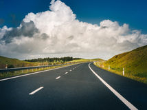 Car road under beautiful solar sky Royalty Free Stock Image