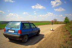 Car at road under repair Royalty Free Stock Photos