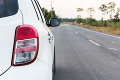 The car on the road. The white car is parked on the street Royalty Free Stock Photo