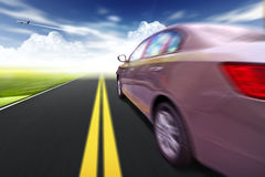Car on the road wiht motion blur background. Royalty Free Stock Photo