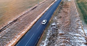 Car on the road in winter. In aerial view stock video