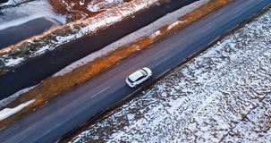 Car on the road in winter. In aerial view stock footage