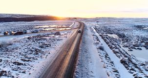 Car on the road in winter. In aerial view stock video footage