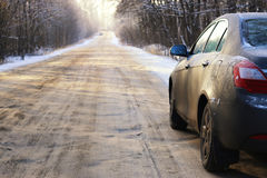 Car on the road in winter Stock Photo