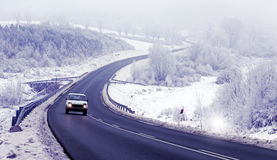 Car on road in winter Royalty Free Stock Image
