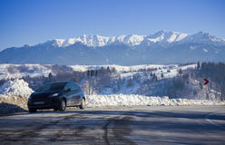 Car and road in winter mountain landscape Royalty Free Stock Photo
