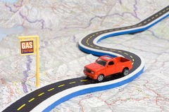 Car on roadmap. Toy car on roadmap showing petrol station Stock Image