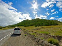 Car roadside mountains landscape Royalty Free Stock Image