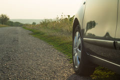 A car on the roadside. In sunset time stock photography