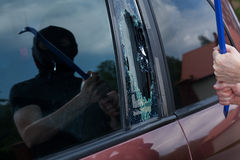 Car robber with crowbar Royalty Free Stock Photo