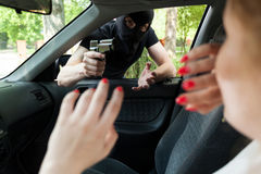 Car robbery Stock Images