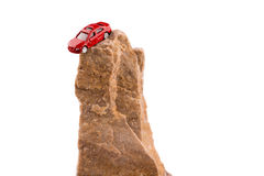 Car on a rock. Red car near on a rock on a white background Royalty Free Stock Image