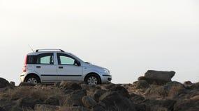 Car on rocks Royalty Free Stock Image