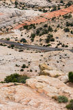 Car on a rocky desert highway in southern Utah Stock Images