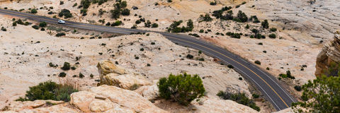 Car on a rocky desert highway in southern Utah Stock Photos