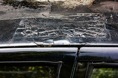Car roof paint decay and rusty. Close up car roof paint decay and rusty that do not care in disrepair stock photo