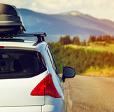 Car with a roof rack. Car for traveling with a roof rack on a mountain road Stock Photos