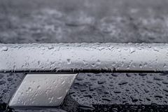 Car roof railing abstract closeup with rain drops, T letter shape stock images