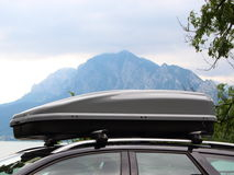 Car Rooftop Box with Mountain and Lake in Background Stock Photography